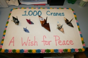 The Tredway Library shared this cake, decorated with paper cranes, with the Augustana community.