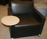 Black chair with round tablet arm