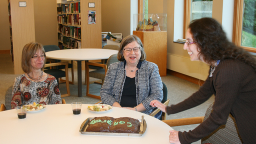 Members of the library staff gathered to celebrate, among other things, Carla Tracy's award as Illinois Academic Librarian of the Year.  Librarian Sarah Horowitz made the chocolate cake in the shape of an open book.