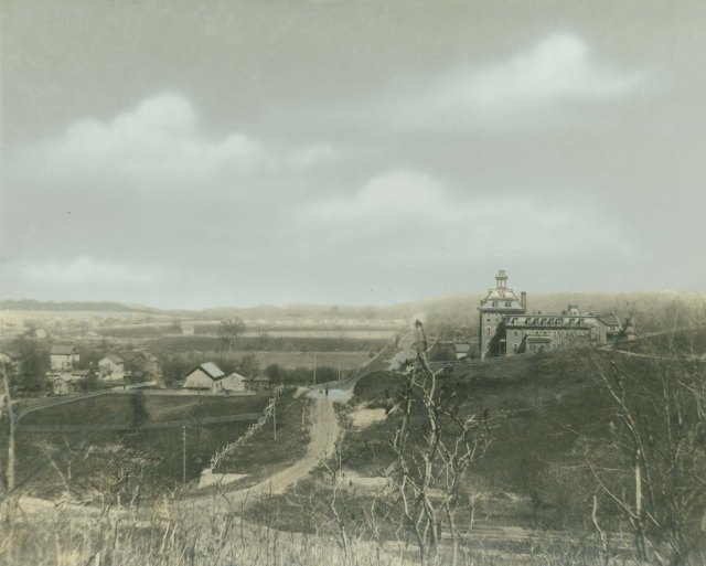 A hand-colored photograph of the First Building on Augustana's Rock Island campus, Special Collections C-L00022