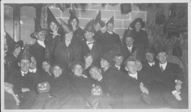 C-F01311, Students in costume celebrating All Hallows Eve, 1914. Augustana College Special Collections Photograph Collection.