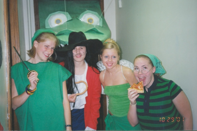 C-S00777, Jennifer Albert, Sarah Todd, Bethany Cagle, and Katie Niehause dressed up for a Halloween party in Andreen Hall. Augustana College Photograph Collection.